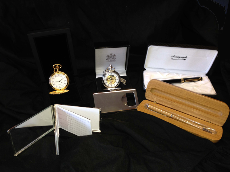 Pocket watches, presentation pens, bottle opener, address book are all great gifts.