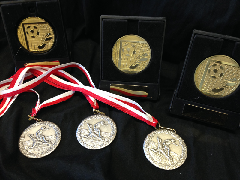 Football presentation medals, medals with ribbons.