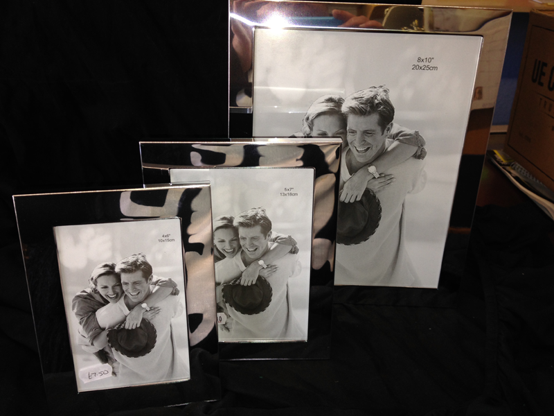 Picture frames of different sizes, engraved or left plain for a gift.