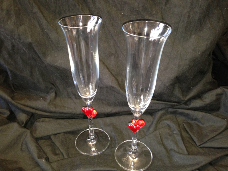 Pair of lovely champagne flutes with heart stems, great for Valentines Day or Anniversary.