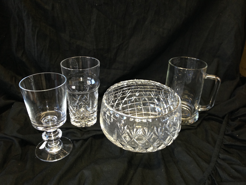 Large selection of cut glass and crystal stylish goblets and vases.